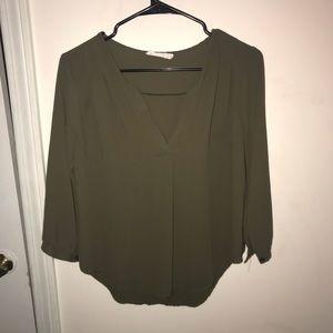 Olive green slight v-neck blouse.